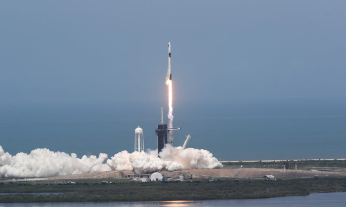 The SpaceX Falcon 9 rocket with the manned Crew Dragon spacecraft attached takes off from launch pad 39A at the Kennedy Space Center in Cape Canaveral, Fla. on May 30, 2020. (Joe Raedle/Getty Images)