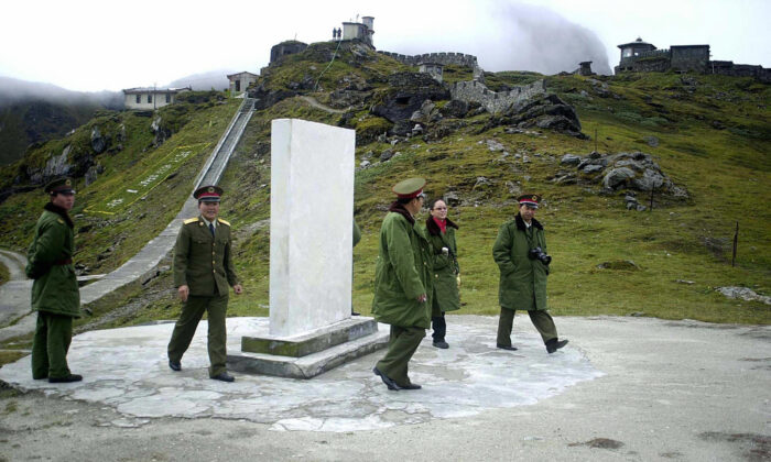 Chinese soldiers at the Nathu La Pass area at the India–China border in the northeastern Indian state of Sikkim in August 2003. The two sides had a minor face-off at another pass called Naku La on Jan. 20, 2021, according to the Indian army. (STR/AFP via Getty Images)