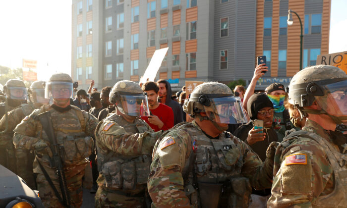 National Guard members are seen near protesters in Minneapolis, Minn., on May 29, 2020. (Lucas Jackson/Reuters)