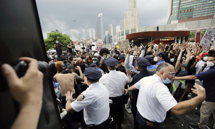 Police try to contain protesters during a rally at the Barclays Center in the Brooklyn borough of New York on May 29, 2020. (Frank Franklin II/AP Photo)