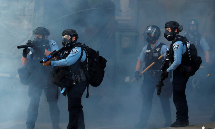 Police officers are seen during a protest against the death in Minneapolis police custody of African-American man George Floyd, in Minneapolis, Minn., on May 29, 2020. (Lucas Jackson/Reuters)