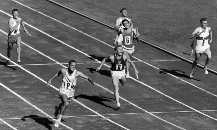 Bobby Joe Morrow, bottom left, of the United States, crosses the finish line to give the U.S. team the gold medal for the 4 x 100 meters relay at the Summer Olympic Games in the Olympic Stadium in Melbourne, Australia, on Dec. 1, 1956. (AP File Photo, Pool)