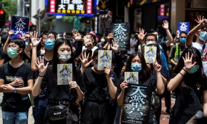 Pro-democracy protesters gather in Causeway Bay district of Hong Kong on May 24, 2020. (Isaac Lawrence/AFP via Getty Images)