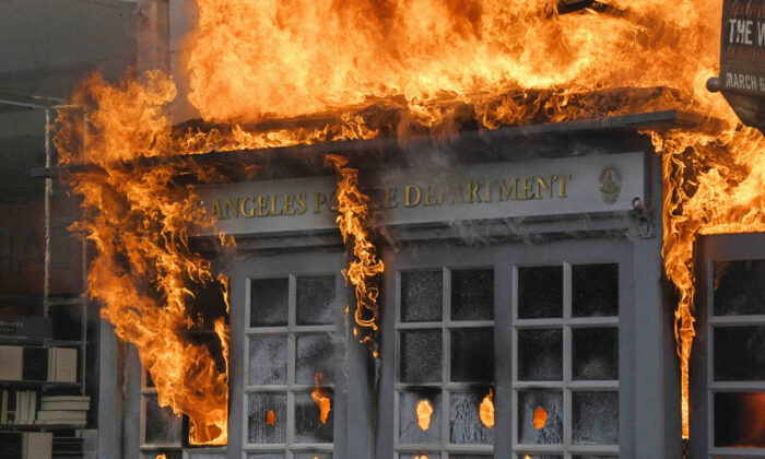A Los Angeles Police Department kiosk is seen ablaze in The Grove shopping center during a protest over the death of George Floyd, in Los Angeles, Calif., on May 30, 2020. (Mark J. Terrill/AP Photo)