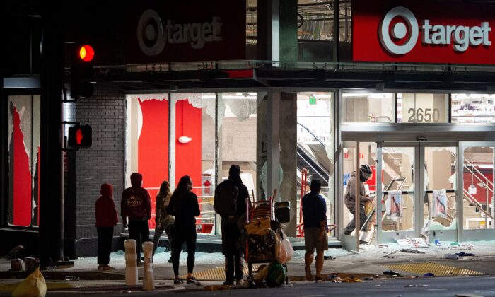 Looters rob a Target store as protesters face off against police in Oakland, Calif., on May 30, 2020. (Josh Edelson/AFP/Getty Images)