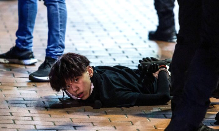 Undercover police arrest and handcuff a pro-democracy demonstrator (C) during a pro-democracy protest in Mong Kok district of Hong Kong on May 10, 2020. (Isaac Lawrence/AFP via Getty Images)