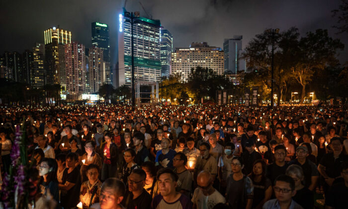 People hold candles as they take part in a candlelight vigil at Victoria Park in Hong Kong on June 4, 2019. (Anthony Kwan/Getty Images)