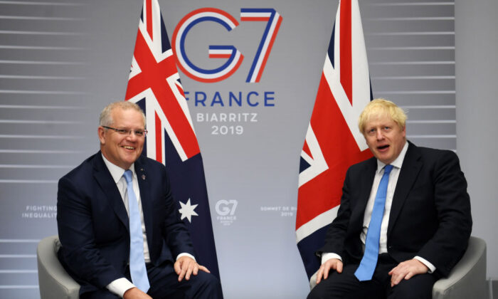 British Prime Minister Boris Johnson (R) meets Australian Prime Minister Scott Morrison (L) for their bilateral talks during the G7 Summit in Biarritz, France on Aug. 24, 2019. (Pool/Getty Images)
