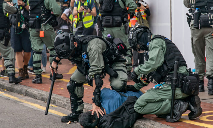 A pro-democracy supporter is detained by riot police during a protest in Hong Kong on May 24, 2020. (Anthony Kwan/Getty Images)