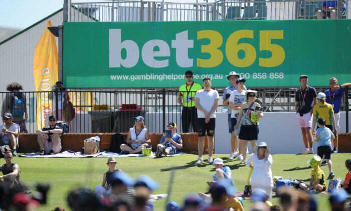 Signage for an online sports betting company is seen at the WACA ground for Ashes cricket Test match in Perth, Australia, December 14, 2017.       (GREG WOOD/Getty Images)