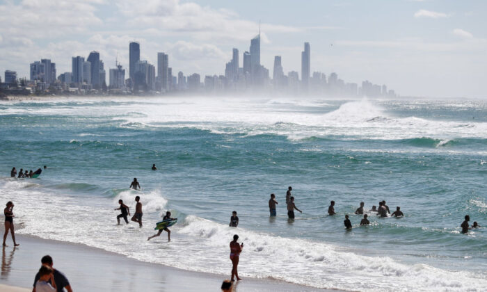 People swim at Burleigh Heads beach on May 16, 2020 in Gold Coast, Australia. (Chris Hyde/Getty Images)