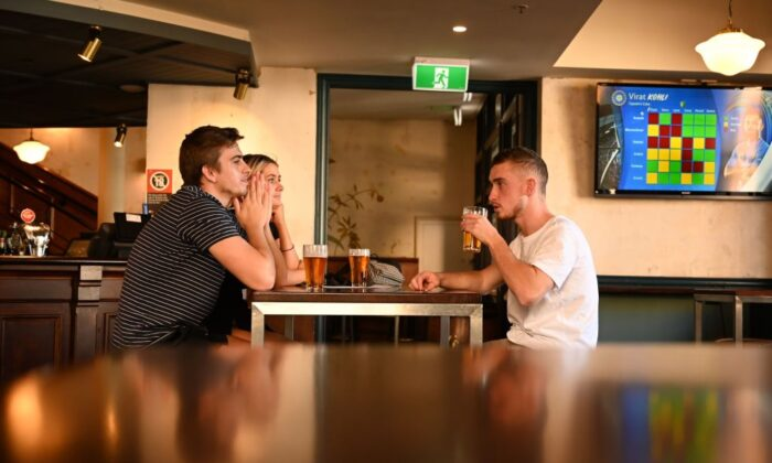 Patrons drink beer at a pub in the Rocks area of Sydney on June 1, 2020. (Peter Parks/AFP via Getty Images)