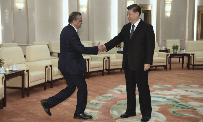 Tedros Adhanom (L), Director General of the World Health Organization, shakes hands with Chinese Leader Xi Jinping before a meeting at the Great Hall of the People in Beijing, China, on Jan. 28, 2020. (Naohiko Hatta - Pool/Getty Images)