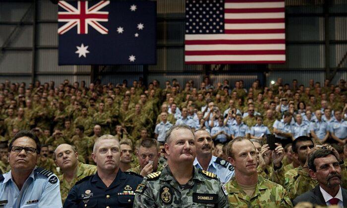 Australian troops and US Marines listen as then-US President Barack Obama delivers an address at RAAF Base Darwin on November 17, 2011. (Saul Loeb/AFP via Getty Images)