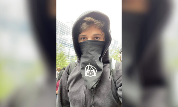 An anarchist identified as Brian Jordan Bartels was captured on video damaging a police car in Pittsburgh, Penn., on May 30, 2020. (Pittsburgh Bureau of Police)