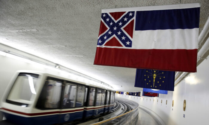 The Mississippi state flag, which incorporates the Confederate battle flag, hangs with other state flags in the subway system under the U.S. Capitol in Washington on June 23, 2015. (Jonathan Ernst/Reuters)