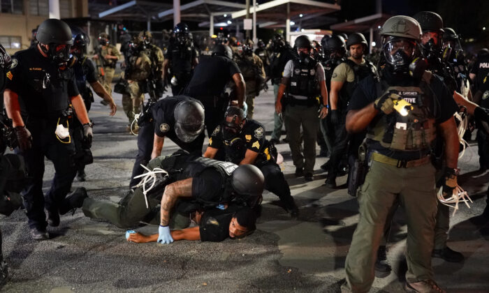 Police detain a protester during a protest in Atlanta, Ga., on May 30, 2020. (Elijah Nouvelage/Getty Images)