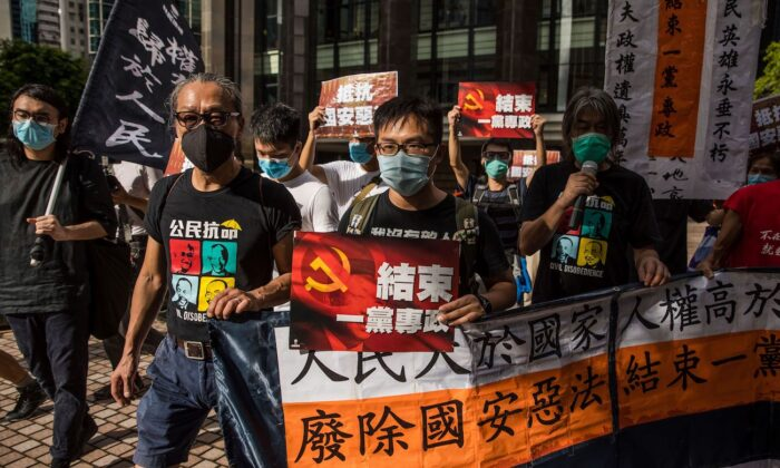 Pro-democracy prostesters march during a rally against a new national security law in Hong Kong on July 1, 2020. (Dale de la Rey/AFP via Getty Images)