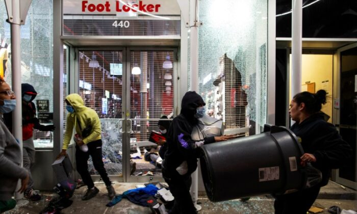 Looters target a store in the Manhattan borough of New York City on June 1, 2020. (Eduardo Munoz/Reuters)