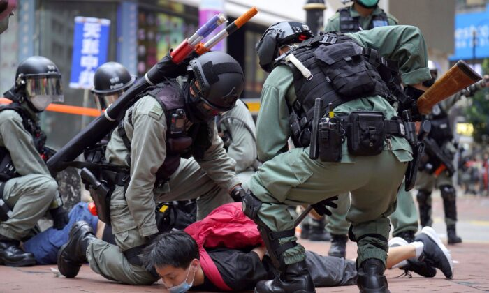 Riot police detain a protester during a demonstration against Beijing's national security legislation in Causeway Bay in Hong Kong on May 24, 2020. (AP Photo/Vincent Yu, File)