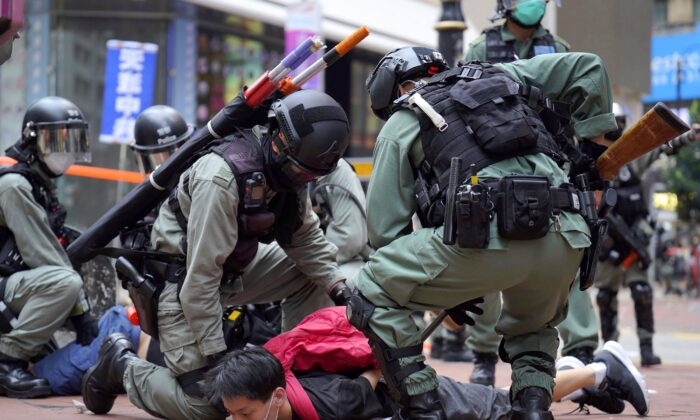 Riot police detain a protester during a demonstration against Beijing's national security legislation in Causeway Bay in Hong Kong on May 24, 2020. (Vincent Yu/AP Photo)