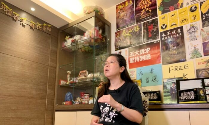 Office worker Daisy Lam speaks to Reuters about her experience in joining the annual June 4 candlelight vigil, at her living room in Hong Kong, China, on June 1, 2020. (Yoyo Chow/Reuters)