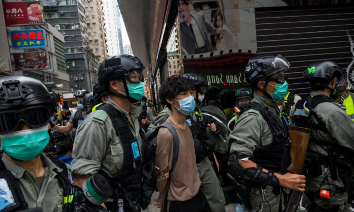 Hong Kong protesters are arrested by riot police during a rally against China's national security law at Mongkok district in Hong Kong on May 27, 2020. (Billy H.C. Kwok/Getty Images)