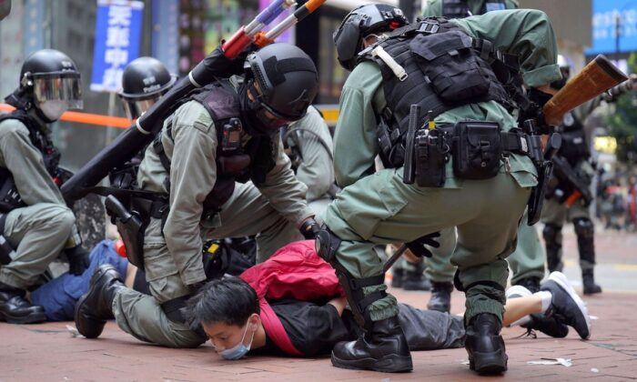 Riot police detain a protester during a demonstration against Beijing's national security legislation in Causeway Bay in Hong Kong on May 24, 2020. (AP Photo/Vincent Yu)