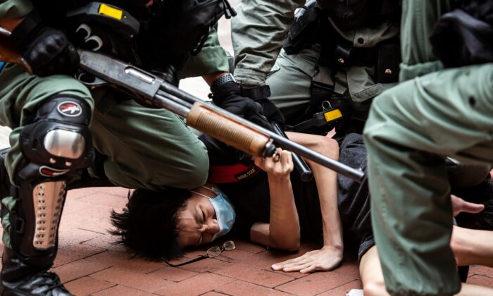 Pro-democracy protesters are arrested by police in the Causeway Bay district of Hong Kong on May 24, 2020. (Isaac Lawrence/AFP via Getty Images)