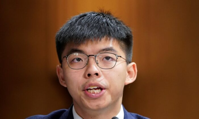 """In this file photo, Joshua Wong, secretary-general of Hong Kong's pro-democracy Demosisto party and leader of the """"Umbrella Movement,"""" testifies at a Congressional-Executive Commission on China (CECC) hearing on Capitol Hill in Washington, on Sept. 17, 2019. (Joshua Roberts/Reuters)"""