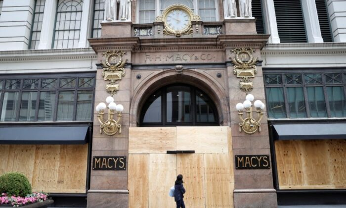 A woman walks past the Macy's store in Herald Square after it was looted and damaged by protesters who participated in demonstrations against the death of George Floyd, in the Manhattan borough of New York City, on June 2, 2020. (Mike Segar/Reuters)