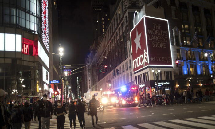 Police vehicles park outside Macy's flagship Herald Square store in New York city after it was broken into on June 1, 2020. (Wong Maye-E/AP Photo)