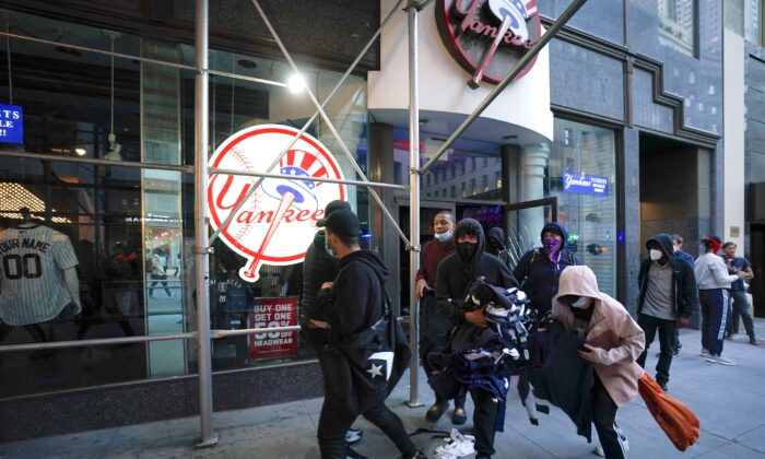 Protesters loot a NY Yankee store during demonstrations over the death of George Floyd, in New York City, on June 1, 2020. (Bryan R. Smith/AFP/Getty Images)