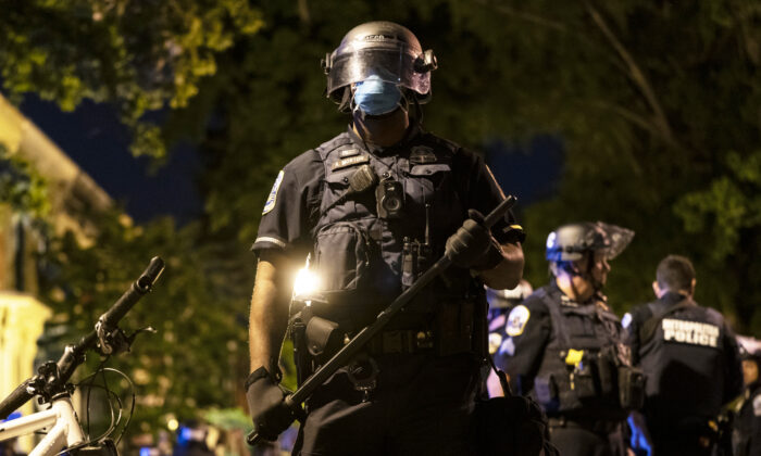 A Metropolitan police officer stands ready during a demonstration in Washington on June 1, 2020. (Joshua Roberts/Getty Images)