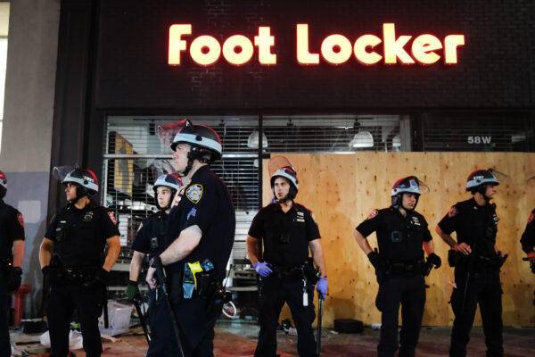Police stand guard near looted stores