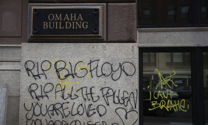 Graffiti in downtown Omaha, Neb., May 31, 2020. (Anna Reed/Omaha World-Herald via AP)