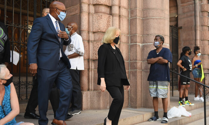 St. Louis City Mayor Lyda Krewson joins protesters as they demonstrate against police brutality and the death of George Floyd outside the St. Louis City Justice Center and City Hall  in St Louis, Mo., on June 1, 2020. (Michael B. Thomas/Getty Images)