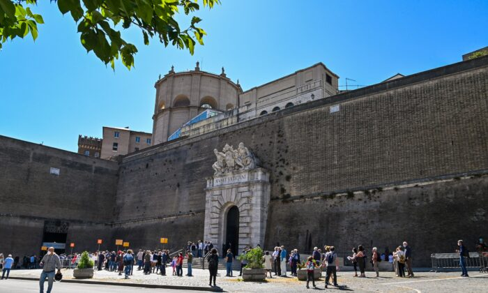 Visitors line up to enter the Vatican Museums (Musei Vaticani) which reopen to the public in The Vatican on June 1, 2020. (Andreas Solaro/AFP via Getty Images)