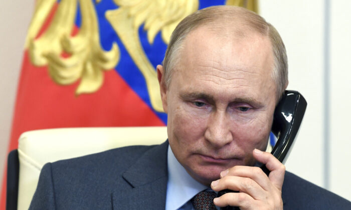 Russian President Vladimir Putin speaks on the phone during a meeting with Russian Prime Minister Mikhail Mishustin via teleconference at the Novo-Ogaryovo residence outside Moscow on June 2, 2020. (Alexei Nikolsky, Sputnik, Kremlin Pool Photo via AP)