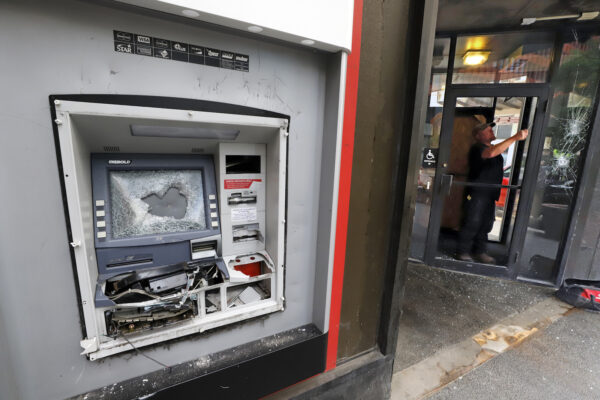 A damaged ATM machine outside a KeyBank branch in downtown Pittsburgh