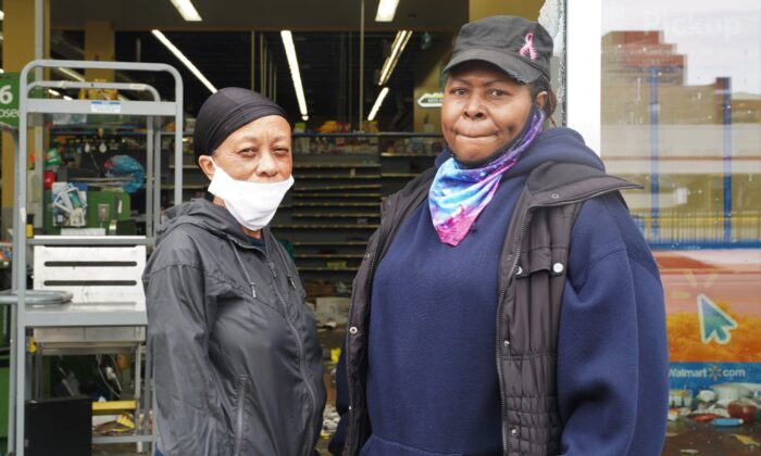 Local residents Diana Washington and Dacia Dixon stand in front of a looted Walmart in the Bronzeville neighborhood of Chicago, on June 1, 2020. (Cara Ding/The Epoch Times)