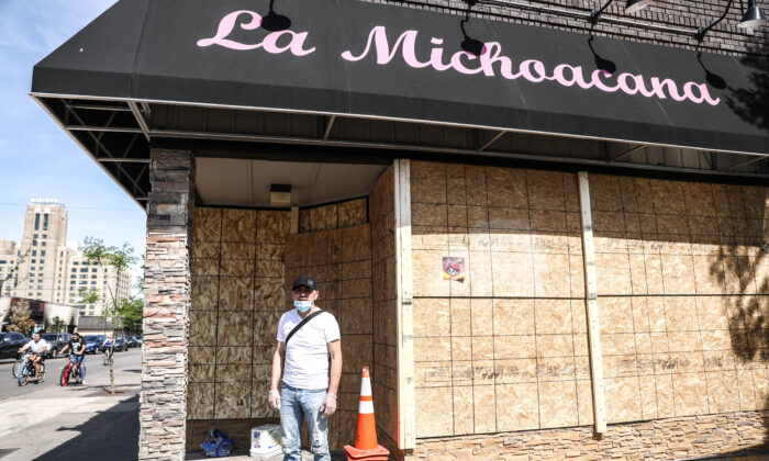Ricardo Espin stands outside his ice cream shop after the fifth night of protests and violence following the death of George Floyd, in Minneapolis, Minn., on June 1, 2020. (Charlotte Cuthbertson/The Epoch Times)