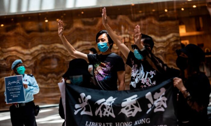 """Pro-democracy protesters gather during a """"Lunch With You"""" rally at a shopping mall in the Central district of Hong Kong on June 1, 2020. (Issac Lawrence/AFP via Getty Images)"""