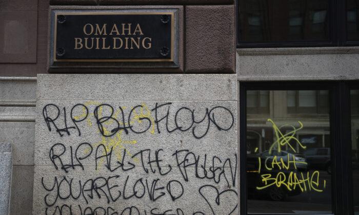 Graffiti in downtown Omaha, Neb., on May 31, 2020. (Anna Reed/Omaha World-Herald via AP)