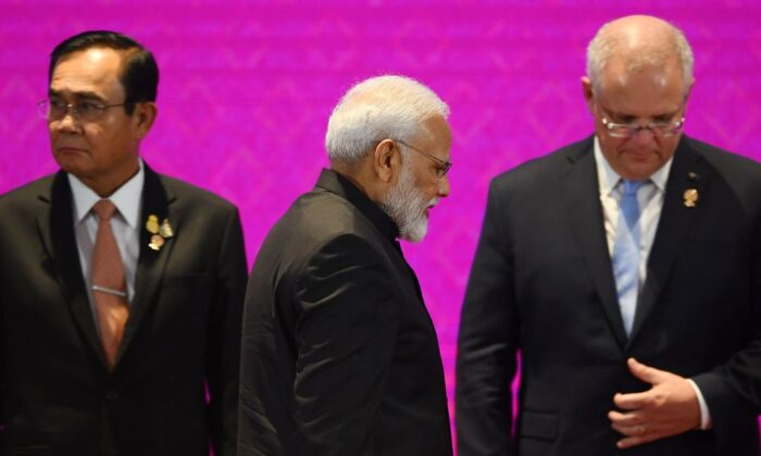 India's Prime Minister Narendra Modi walks past Thailand's Prime Minister Prayut Chan-O-Cha (L) and Australia's Prime Minister Scott Morrison (R) during the 14th East Asia Summit in Bangkok on November 4, 2019, on the sidelines of the 35th Association of Southeast Asian Nations (ASEAN) Summit. (Manan Vatsyayana/AFP via Getty Images)