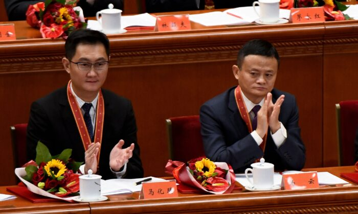 "Alibaba's co-founder Jack Ma (R) applauds with Tencent Holdings' CEO Pony Ma during a meeting marking the 40th anniversary of China's ""reform and opening up"" policy at the Great Hall of the People in Beijing on Dec. 18, 2018. Holdings in the two Chinese companies are two of the Canada Pension Plan's biggest investments in publicly traded stocks. (Wang Zhao/AFP via Getty Images)"