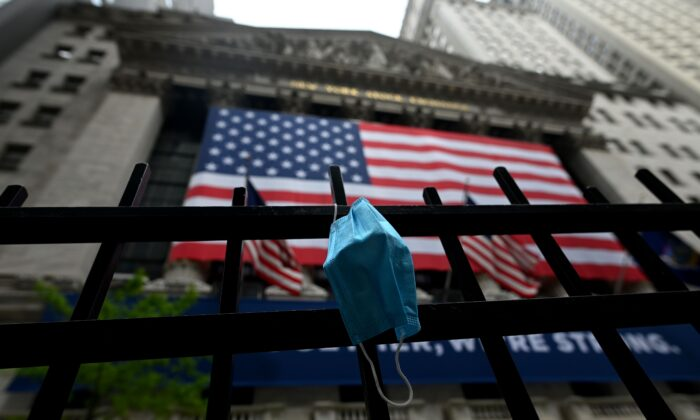 A face mask is seen in front of the New York Stock Exchange (NYSE) at Wall Street in New York City, on May 26, 2020. (Johannes Eisele /AFP/Getty Images)