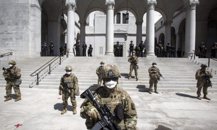Members of California National Guard stand guard outside the City Hall in Los Angeles, Calif., on May 31, 2020. (Ringo H.W. Chiu/AP Photo)