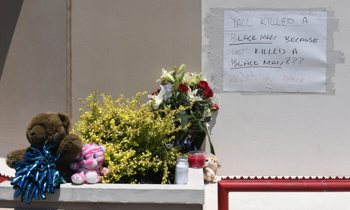 Flowers and messages are left at a memorial for David Dorn, a 77-year-old retired police captain who was murdered during overnight rioting outside Lee's Pawn and Jewelry, on June 2, 2020 in St Louis, Mo. (Michael B. Thomas/Getty Images)