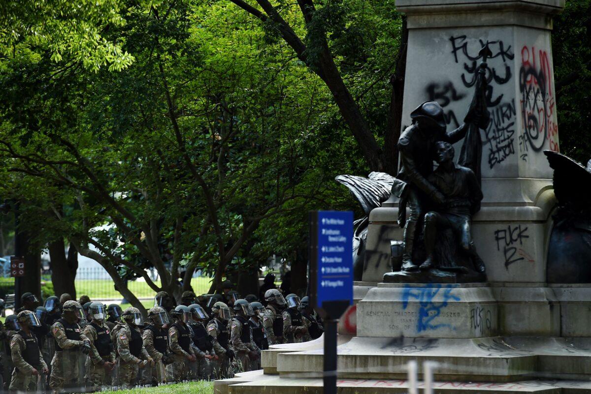 defaced monument riot Washington